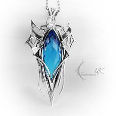 Silver and topaz necklace by LUNARIEEN.