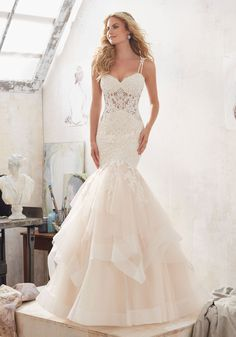 DiamantŽ Beaded, Alençon Lace AppliquŽés Adorn the Bodice of this Glamorous Mermaid Wedding Dress. The Flounced Tulle Skirt is Accented with Horsehair Trim. Appliquéd Double Shoulder Straps Complete the Look