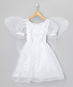 Glittering stars shimmer atop the layers of pouf on this angelic dress. It zips on easily and pairs with the halo headband and mesh wings for a look that's ready to soar!Includes dress, wings and headband100% polyesterHand wash; dry flatImported