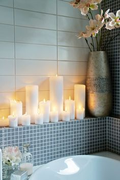 Details Make a Difference – The final detail in adding that spa like feeling to your bath? Add candles! Candles add that magical glow that makes that long soak in the bath special. Consider creating a wall grouping of candles for dramatic effect. Or create unusual holders,