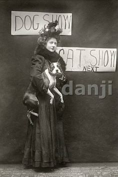 Woman with her classic Boston terrier at a dog show 1908