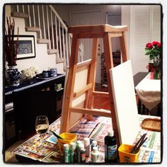 A DIY paint night, for a fraction of the cost of BYOB classes. Notice the stool use! Great for a stay at home date night or girls night-in idea.