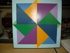 This barn 2x2 barn quilt is called' Spinning Color Wheel and is currently displayed in Ste, Genevieve, MO
