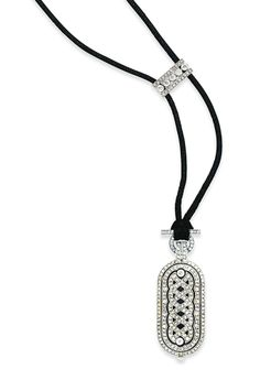 AN EARLY 20TH CENTURY DIAMOND PENDANT WATCH, BY CARTIER Of elongated oval outline, the front with millegrain-set rose-cut diamond openwork plait motif within a similarly-set double line border, the silvered dial to the reverse with black painted Roman numerals and blued steel hands, to a plain bezel surround and rose-cut diamond crown, hung from a black cord with old and rose-cut diamond rectangular toggle, mechanical movement, circa 1920