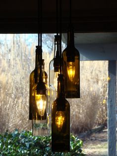 Wine Bottle DIY Chandelier.  I would like this on the porch, but would worry about the wind.....