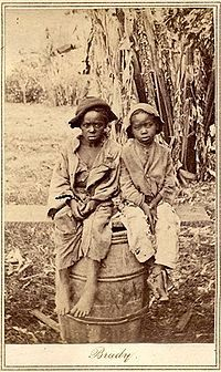 Two children who were likely emancipated during the Civil War, circa 1870.