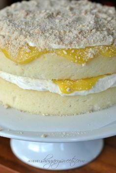 Homemade Lemon Cake with a layer of creamy lemon frosting and fresh lemon curd #cakerecipe #lemon