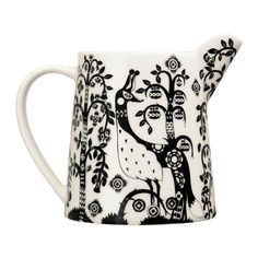 Pitcher Add the iittala Taika White/Black 17 oz. Pitcher to your iittala dinnerware collection. Klaus Haapaniemi's whimsical pattern now adorns a perfectly petite porcelain pitcher that is charming yet versati. Modern Pitchers, Contemporary Furniture, Classic Dinnerware, Table Design, Kartell, Ceramic Tableware, Coffee And Tea Accessories, Marimekko, Home