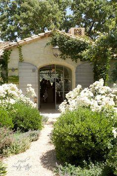 Front door to spanish style Patina Farm with flowers White Gardens, Farm Gardens, Outdoor Gardens, Spanish Style Homes, Spanish House, Ste Cecile, Dream Garden, Home And Garden, Mediterranean Garden Design