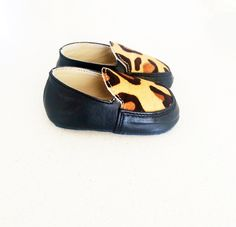 Made from Genuine Leather with pony hair front. Please keep in mind that they are  hand made.We recommend measuring your child's foot (standing up) and ordering a CM up in size if you are unsure, as they are loafers and have no elastic.Please note with the custom size option these are made to order and can take 4 weeks (may be less)