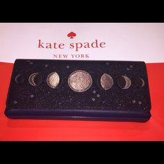 "Kate Spade moon clutch Beautiful Kate Spade Lido Avenue moon clutch!!  Dark blue with a glitter finish flap adorned with different sized grey moons and stars. Magnetic snaps tabs hold the flap closed.  Interior is lined with Blue Kate Spade fabric and has a multi function slip pocket on one side.  10"" x 4.5"" x 1.25"". Comes with Kate Spade care card and gift bag.  No Trades kate spade Bags Clutches & Wristlets"