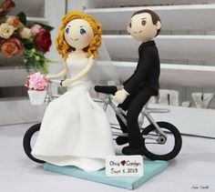 Wedding cake topper, wedding clay couple with tandem bike clay miniature, engagement clay doll decoration, clay rings holder, clay miniature on Etsy, $115.50