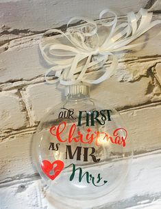 This our first Christmas ornament will make a great gift for a wedding shower or just something you want for yourself. It is made using a frosted glass ornament and outdoor grade vinyl so it will last forever. Add the year to the back if you would like. Ordering is simple, comes as is but if you want year added I need to know when you place the order.