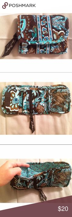Vera Bradley Wallet Never used. Cash pocket, 3 card pockets, ID sleeve, coin pocket. Velcro closer. Comment with questions or make an offer! Turquoise, shade of turquoise, brown, white. Comment with any questions or make an offer, thanks! (I do have 4 other items in my closet with the same Vera Bradley pattern, if you wanted to make a bundle) Vera Bradley Bags Wallets