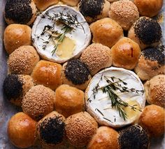 The ultimate easy-going food for a crowd: a tear-and-share dough ball platter, served with rosemary-spiked gooey cheese, ready for some serious dipping