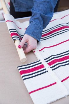 Create a handy (and stylish!) firewood tote just in time for winter weather by simply repurposing a rug.