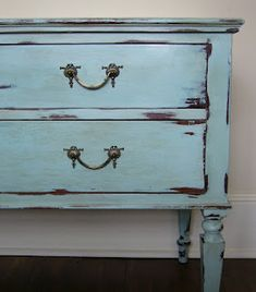 Annie Sloan Chalk Paint 1 part 'Provence' mixed with 2 parts 'Old White'.  Waxed with clear, dark,  clear, again.