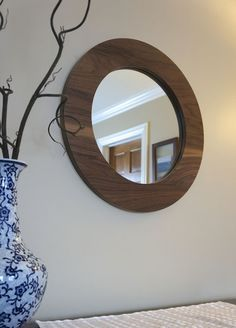 This decorative wall mirror is handmade of solid walnut wood and provides a beautiful, modern accent to a bathroom, bedroom or any other room in your … Huge Mirror, Round Mirrors, Diy Vanity Mirror, Spiegel Design, Seattle, Hollywood Mirror, Mirror Mosaic, Steel Structure, Walnut Wood