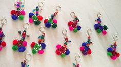 Handcrafted with 4 wool pom poms, miror and different colored/sized beads. Many uses including keyring, zipper pull, keychain, BOHO Chic Bag Charms. As the product is handcrafted each keyring is unique. Pom Poms, Bag, Unique Jewelry, Handmade Gifts, Crafts, Etsy, Vintage, Kid Craft Gifts, Manualidades