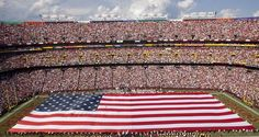 The Redskins and New York Giants opened the 2011 season on 9/11 with the unfurling of the U.S. flag across FedExField.