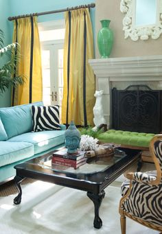 living room with blue and green and zebra