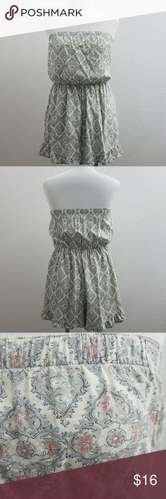 """Abercrombie & Fitch Strapless Romper Strapless ruffle hem romper by Abercrombie & Fitch.  Elasticized top/ waist and lined from the waist to hem.  Size S.  Approximate measurements: 13.25"""" across the top and waist 11.5"""" unstretched.  In very good pre-owned condition. Abercrombie & Fitch Dresses"""