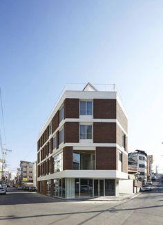 따뜻한 벽돌집 : 모던스타일 주택 by 스마트건축사사무소
