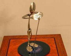 The Singer - made from silverware and mounted on a 45 record. Welded Art, 45 Records, One More Step, Welding, Metal Art, Ceiling Fan, Create Yourself, Singing, Sculpture