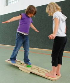 Erzi balance games combine fun, exercise, concentration and balance.  This is the Rocky Board, a balance seesaw board with 3 marbles that have to be moved from one side to the other. Let the fun begin!