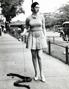 """vintagegal: """" Burlesque dancer Zorita walks her pet snake, 1937 """""""