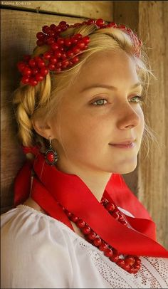 Beautiful young blonde haired girl from the Ukraine wearing red.