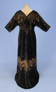FORTUNY STENCILED VELVET GOWN, EARLY 20th C. Short sleeve black silk velvet with V-neck and back, front lacing with silk cord, slightly gathered at either side of bust into a pair of Murano glass beads, waistline shaped by silk cord strung at sides and back through glass beads, gold stenciling in large scale foliate design. The stenciling is from a design in Jacopo Bellini's sketchbook of  15th century Italian Renaissance textile designs. Back