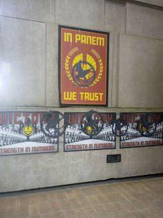 Capitol propaganda with Mockingjay graffiti spray painted over it on the Mckingjay set in Paris!