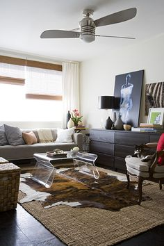 living room, family room, cowhide rug, acrylic table, ceiling fan, painting