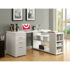 """This """"L"""" shaped computer desk will be a stunning focal point in your contemporary home office. This simple and stylish piece features thick panels and clean lines, in a white finish. The writing desk offers a spacious work surface that is great for doing paperwork, or for using with a computer. The secondary surface offers an additional work space, and extra adjustable shelves that can be used for a printer or other important items. This piece also features two medium storage drawer..."""