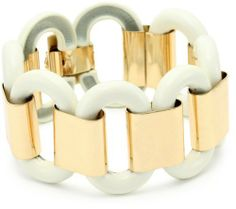 Anne Klein Gold-Tone and Ivory Flex with Buckle Accent Stretch Bracelet Anne Klein. $24.99. Gold-toned plating Made in CN. Made in China. Gold-toned plating. Stack this bracelet with your favorite watch or other bold bracelets. Save 44%!