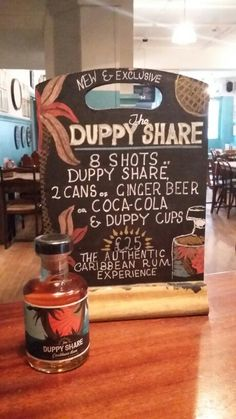 The Duppy Share PoS sign with bottle  - exclusive offer at The Smuggler's