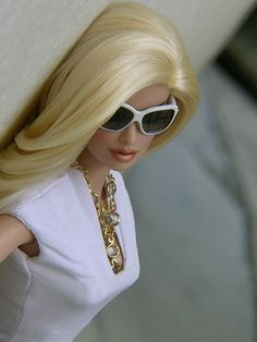 ℒℴ⌵ℰ Barbie with a gold necklace, white t-shirt and white sunglasses