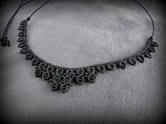 Black macrame necklace adorned with black beads. To wear everyday. Stylish. Fits all styles.