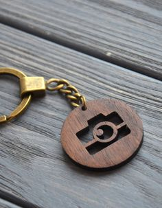 Camera Keychain Custom Wooden Engraved Gift for Friend Dad Sister Personalized Key Chain Gift for Photographer Key Ring   Welcome! We are really happy to see you in our shop.   This keychain would be a wonderful cute favor for any occasion.  ✓ It can be engraved with anything you would like to: name, logo, funny inscription, picture etc. Also we can add engraving on both sides of the comb.  ✓ This keychain is a wonderful gift for any occasion. ✓ You can choose from 3 wood types we offer and…
