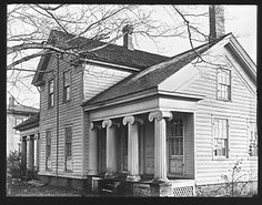 I'm pretty sure this is the house Tim lived in when we met!!! [Greek Revival Farmhouse with Ionic Capitals on Porch, New York State]