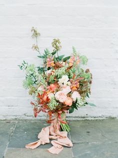 Stunning Wedding Bouquet With Orange, Pale Pinks & Greens | Sky Blue & Coral Wedding Inspiration For An Elegant Shoot In A Glasshouse At The Bombay Sapphire Distillery With Images From Julie Michaelsen Photography