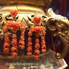 Gold and carved coral girandole earrings. Italy 19th century