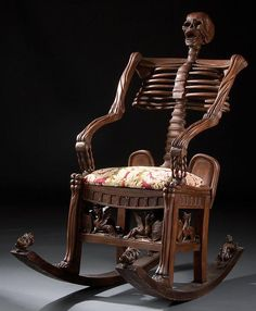 Very cool!! Skeleton rocking chair, Russian, 19th century. Notice the little dragons or gryphons around the bottom. I LOVE this!