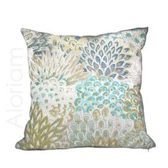 This elegant modern floral pillow cover features a richly textured brocade fabric woven in colors of silvery beige, turquoise, blue, citrine yellow and