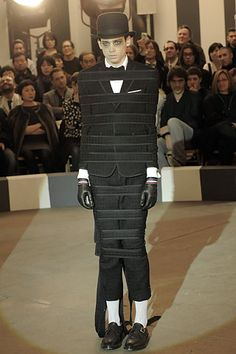 "Thom Browne. Must be the ""Sanitarium Crazy Wear"" appropiate restrained."