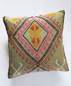 One-of-a-kind vintage Kilim pillow cover Approx. dimensions: 16x16 inches Cut from a 1960's vintage turkish handwoven kilim rug Back is sturdy dark tan-colored cotton with zip closure Each pillow cove