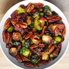 Brussels Sprouts with Bacon, Pecans, and Cranberries 12 oz Brussels sprouts ends trimmed, 2 tablespoons olive oil 1/4 teaspoon salt 4 slices bacon cooked and chopped 1 cup pecans 1/2 cup dried cranberries Roasted Vegetable Recipes, Roasted Vegetables, Veggie Recipes, Cooking Recipes, Healthy Recipes, Veggies, Vegetable Sides, Vegetable Side Dishes, Christmas Side Dishes