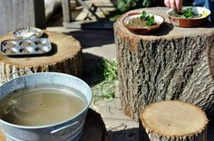 Making mudpies on stumps.