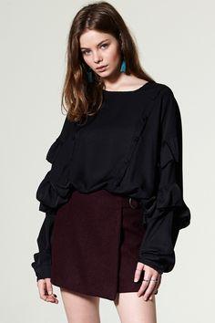 Aristi Wrap Skort Discover the latest fashion trends online at storets.com #coat #fauxfur #shealingcoat